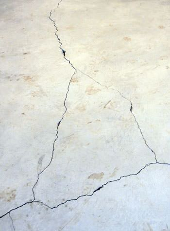 severely cracked, heaving slab floors in a home in Blair