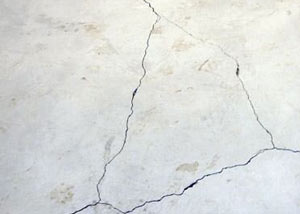 cracks in a slab floor consistent with slab heave in Spencer.