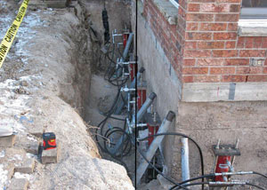 Foundation push piers installed around a house with a foundation settlement issues in Elkhorn