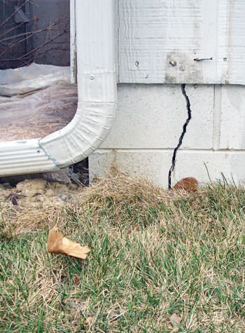 foundation wall cracks due to street creep in Blair