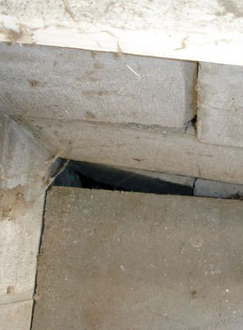 inward rotation of a foundation wall damaged by street creep in a garage in La Vista