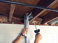 Straightening a foundation wall with the PowerBrace™ i-beam system in a North Platte home.