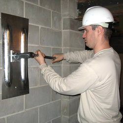 installing a wall anchor to repair an bowing foundation wall in North Platte