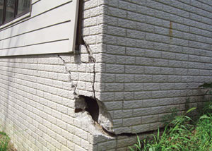 A severely damaged foundation wall in Fremont