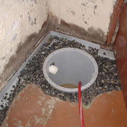 Installing a sump in a sump pump liner in a Sioux City home