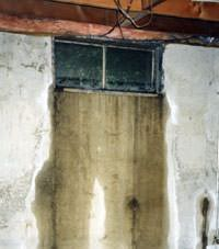 Flooding through basement windows in a Mc Cook home.