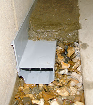 A basement drain system installed in a Kearney home